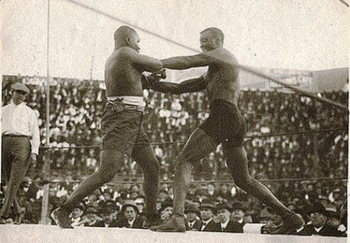 Wills (right) battling the great Sam Langford.