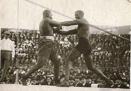 Wills (right) battling the great Sam Langford.