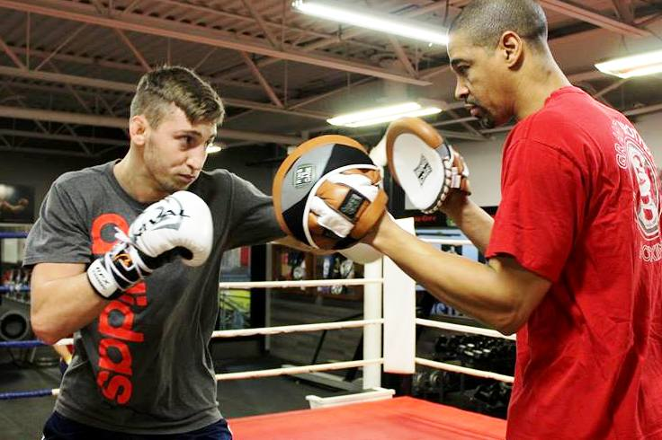 Bruno working the pads with Howard Grant.