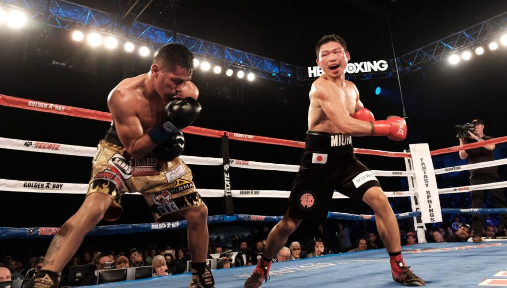Takashi Miura swinging for the fences against Miguel Roman.