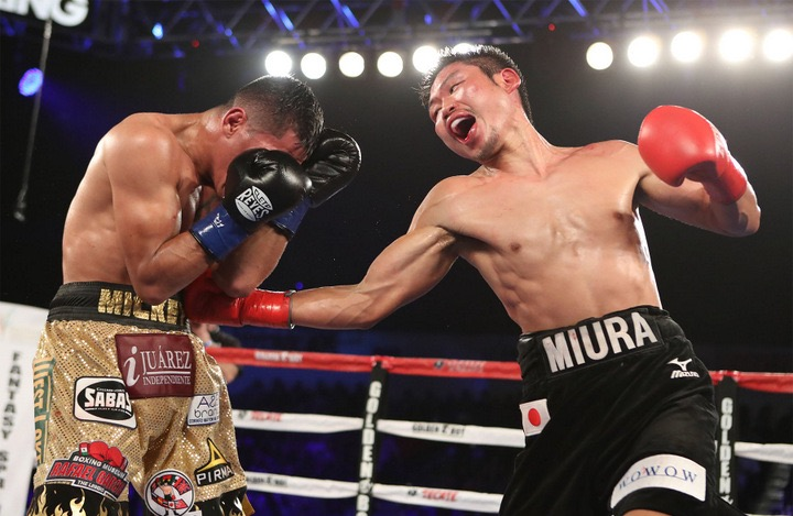 Takashi Miura lands one of many body shots on Miguel Roman during their epic clash.