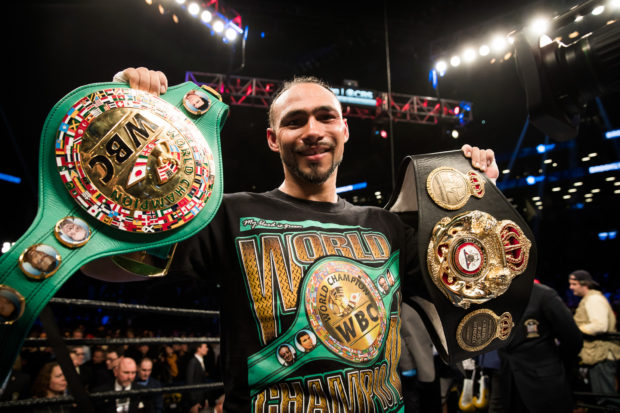 Keith Thurman with his belts.